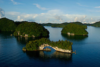 Aerial view of the Rock Islands in the late afternoon with the Natural Arch in the foreground Palau, Micronesia