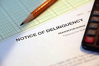 Delinquency Past Due Notice on the Family Work Desk.