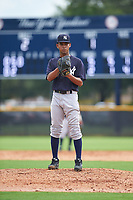GCL Yankees West relief pitcher Deivi Garcia (25) looks in for the sign during the first game of a doubleheader against the GCL Yankees East on July 19, 2017 at the Yankees Minor League Complex in Tampa, Florida.  GCL Yankees West defeated the GCL Yankees East 11-2.  (Mike Janes/Four Seam Images)