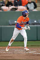 First baseman Dylan Brewer (3) of the Clemson Tigers bats in a game against the Stony Brook Seawolves on Friday, February 21, 2020, at Doug Kingsmore Stadium in Clemson, South Carolina. Clemson won, 2-0. (Tom Priddy/Four Seam Images)