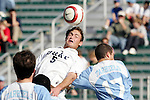 13 November 2005: Duke's Blake Camp (5) plays the ball away from North Carolina's David Boole (17). Duke University defeated the University of North Carolina 5-4 in penalty kicks following a 0-0 draw at SAS Stadium in Cary, North Carolina in the final of the 2005 ACC Men's Soccer Championship.