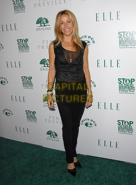 SHERYL CROW.Attends The Elle is Going Green Party and Concert held at Boulevard3 in Hollywood, California, USA..April 5th, 2007 .full length black waistcoat skinny jeans .CAP/DVS.©Debbie VanStory/Capital Pictures