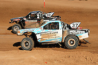 Apr 16, 2011; Surprise, AZ USA; LOORRS driver R.J. Anderson (37) races alongside C.J. Greaves during round 3 at Speedworld Off Road Park. Mandatory Credit: Mark J. Rebilas-.