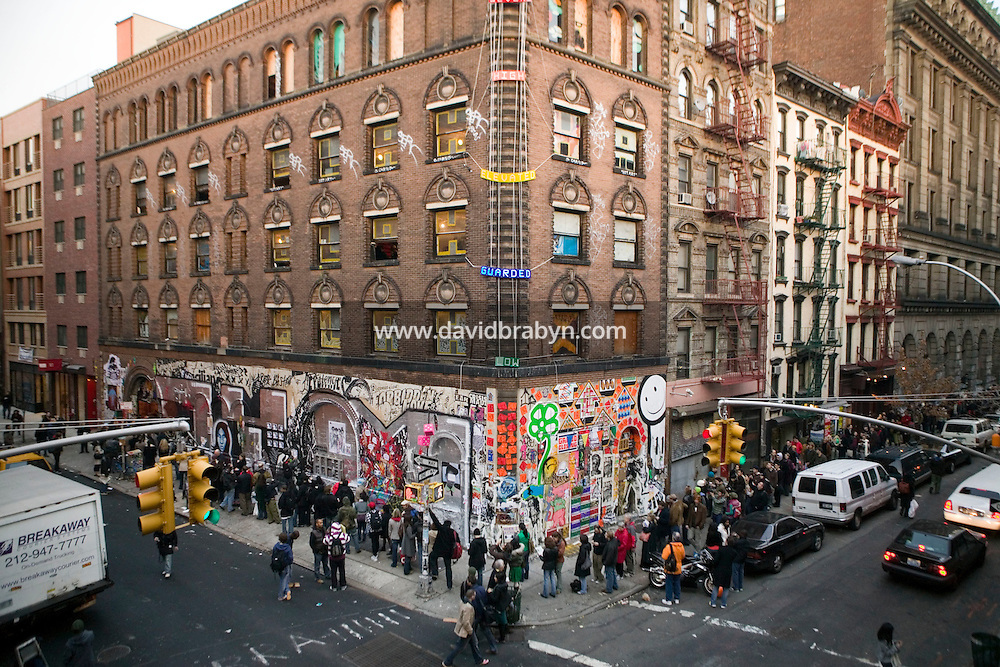 15 December 2006 - New York City, NY - People line up around the block to enter a three-day street art exhibition held in a 19th-century brick building at 11 Spring Street in the NoLIta neighborhood of New York City, USA, 15 December 2006. The building's new owners, Caroline Cummings and Bill Elias, called on the Wooster Collective to curate the show as a last hurrah for a site that long served as a canvas for street art.<br />