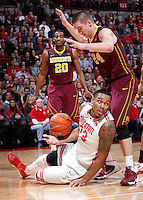 Ohio State Buckeyes center Amir Williams (23) looks to the referee for a foul as he is knocked to the ground by Minnesota Golden Gophers forward Joey King (24) on a layup attempt during the first half of the NCAA men's basketball game between the Ohio State Buckeyes and the Minnesota Golden Gophers at Value City Arena in Columbus, Ohio, on Saturday, Feb. 22, 2014. At the end of the first half, Minnesota led Ohio State, 28-18. (Columbus Dispatch/Sam Greene)
