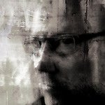 textured image of a man with glasses staring at the camera