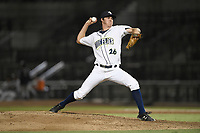 Relief pitcher Trent Johnson (26) of the Columbia Fireflies delivers a pitch during a game against the Charleston RiverDogs on Wednesday, August 29, 2018, at Spirit Communications Park in Columbia, South Carolina. Charleston won, 6-1. (Tom Priddy/Four Seam Images)