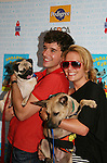 "Ugly Betty's Michael Urie & Becky Newton at Broadway Barks 11 - a ""Pawpular"" star-studded dog and cat adopt-a-thon on July 11, 2009 in Shubert Alley, New York City, NY. (Photo by Sue Coflin/Max Photos)"