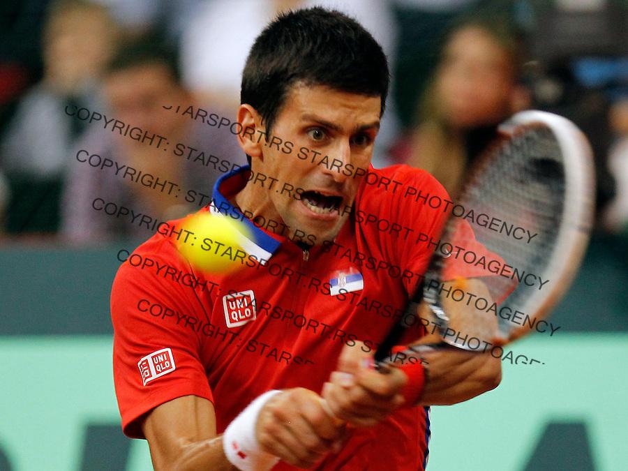 Tennis Tenis<br /> Davis Cup semifinal polufinale<br /> Serbia v Canada<br /> Novak Djokovic v Milos Raonic<br /> Novak Djokovic returns the ball<br /> Beograd, 15.09.2013.<br /> foto: Srdjan Stevanovic/Starsportphoto &copy;
