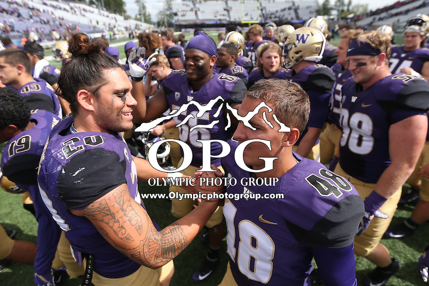 03 September 2016:  Washington's #28 Psalm Wooching congratulates teammates #38 Cameron Van Winkle after the game against Rutgers.  Washington defeated Rutgers 48-13 at the University of Washington in Seattle, WA.