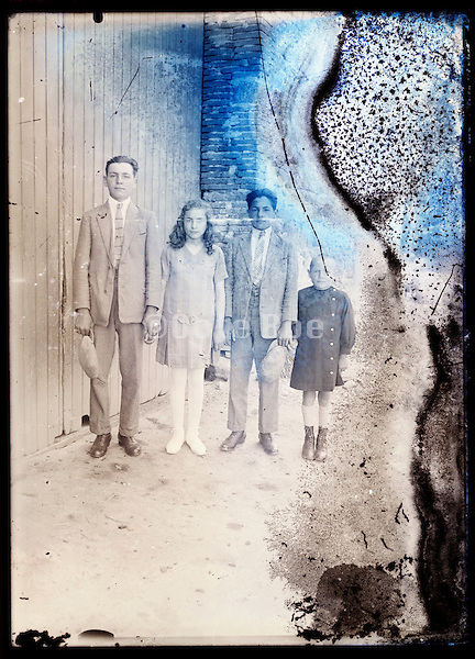 eroding glass plate photo of group image with children