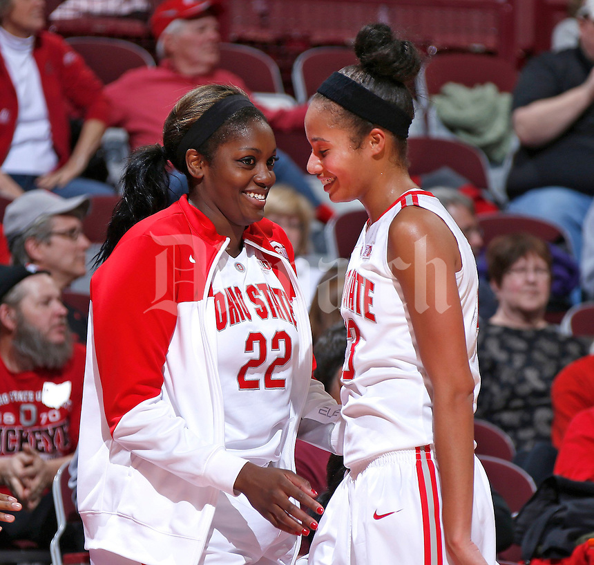 Ohio State Buckeyes forward Martina Ellerbe (23) smiles after a chest bump with teammate Ohio State Buckeyes center Darryce Moore (22) during the second half of the NCAA women's basketball game at Value City Arena on Wednesday, November 27, 2013. (Columbus Dispatch photo by Jonathan Quilter)