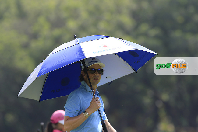 Coach Neil Manchip follows Shane Lowry (IRL) European Team during Pro-Am Day of the 2016 Eurasia Cup held at the Glenmarie Golf &amp; Country Club, Kuala Lumpur, Malaysia. 14th January 2016.<br /> Picture: Eoin Clarke | Golffile<br /> <br /> <br /> <br /> All photos usage must carry mandatory copyright credit (&copy; Golffile | Eoin Clarke)