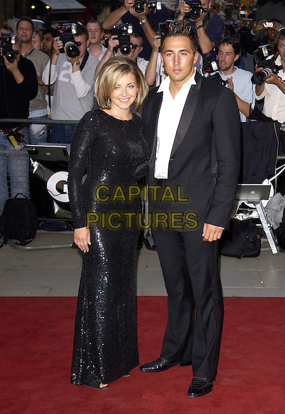 CHARLOTTE CHURCH & GAVIN HENSON.GQ Men Of The Year Awards at the Royal Opera House, Covent Garden, London, WC2..September 6th, 2005.full length celebrity couple boyfriend girlfriend black suit black sequin dress.www.capitalpictures.com.sales@capitalpictures.com.© Capital Pictures.