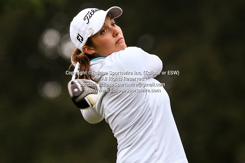 Canada's Sara-Maude Juneau tees off on the first tee at the LPGA Championship at Locust Hill Country Club in Pittsford, NY on June 7, 2013
