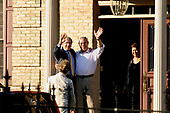McLean, VA - May 31, 2005 -- On short notice, United States President George W. Bush and first lady Laura Bush went to  the home of former Secretary of State Colin L. Powell and his wife Alma.  Powell was dressed in a light-colored dress shirt and khakis (no jacket or tie).  The President embraced him and, turning to wave at the cameras, removed his suit jacket and grinned. The first lady wore a light-colored pantsuit.  The dinner was private, with just the two couples.<br /> Credit: Martin H. Simon - Pool via CNP