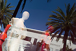 Palm trees reflected in the window of Gucci Rodeo Drive, Beverly Hills, CA