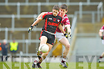 Paul O'Connor Kenmare gets in his shot under pressure from Eamon O'Callaghan Rockchapel during their Munster Club Champiionship semi final in Fitzgerald Stadlium on Sunday