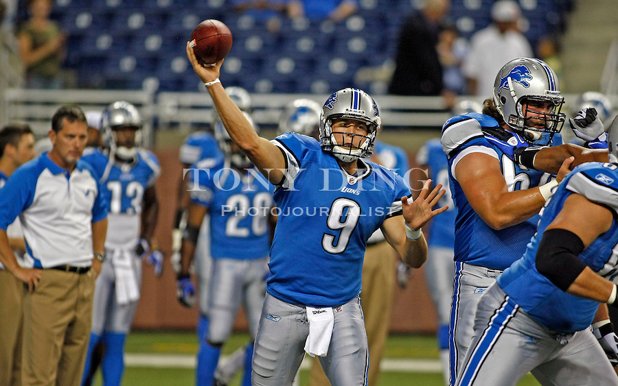 Detroit Lions head coach Jim Schwartz, left, watches quarterback Matthew Stafford (9) throw during warmups before a preseason NFL football game with the Buffalo Bills, Thursday, Sept. 2, 2010, in Detroit. (AP Photo/Tony Ding)