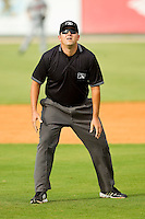 Umpire Drew Maher handles the calls on the bases during the South Atlantic League game between the Rome Braves and the Kannapolis Intimidators at CMC-Northeast Stadium on August 5, 2012 in Kannapolis, North Carolina.  The Intimidators defeated the Braves 9-1.  (Brian Westerholt/Four Seam Images)