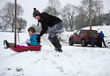 21/01/18<br /> <br /> Chlo&eacute; Kirkpatrick (25) pushes Freya Kirkpatrick (10) down a hill as a car is given a push up hill in the background near Dovedale in the Derbyshire Peak District..<br /> <br /> All Rights Reserved: F Stop Press Ltd. +44(0)1773 550665  www.fstoppress.com.