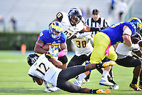 Newark, DE - OCT 29, 2016: Towson Tigers defensive back Keon Paye (12) and Towson Tigers defensive lineman Max Tejada (93) combine for a tackle of Delaware Fightin Blue Hens running back Thomas Jefferson (28) during game between Towson and Delaware at Delaware Stadium Tubby Raymond Field in Newark, DE. (Photo by Phil Peters/Media Images International)