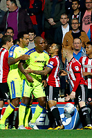 Ryan Woods of Brentford sees Andre Wisdom of Derby County being restrained during the Sky Bet Championship match between Brentford and Derby County at Griffin Park, London, England on 26 September 2017. Photo by Carlton Myrie / PRiME Media Images.