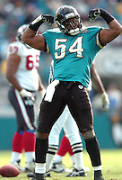 Jacksonville Jaguars linebacker #54 Mike Peterson flexes his muscles after sacking the Houston Texans quarterback at Alltel Stadium in Jacksonville, Fl. (Rick Wilson/The Florida Times-Union)