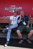 ANAHEIM - JULY 13:  Photographer Michael Zagaris and Sports Illustrated picture editor Nate Gordon sits in the National League dugout before the All Star Game at Angel Stadium on June 13, 2010 in Anaheim, California. Photo by Brad Mangin