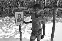 - Mozambique 1993, village occupied by anti-government rebels of RENAMO in the province of Sofala; portrait of their leader Afonso Dhlakama<br />