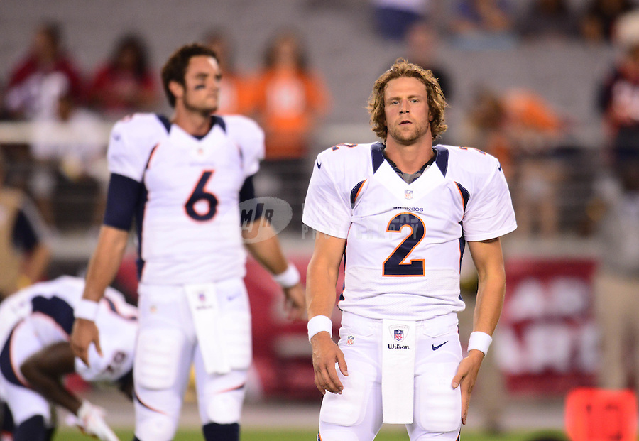 Aug. 30, 2012; Glendale, AZ, USA; Denver Broncos quarterbacks (2) Adam Weber and (6) Brock Osweiler against the Arizona Cardinals during a preseason game at University of Phoenix Stadium. Mandatory Credit: Mark J. Rebilas-
