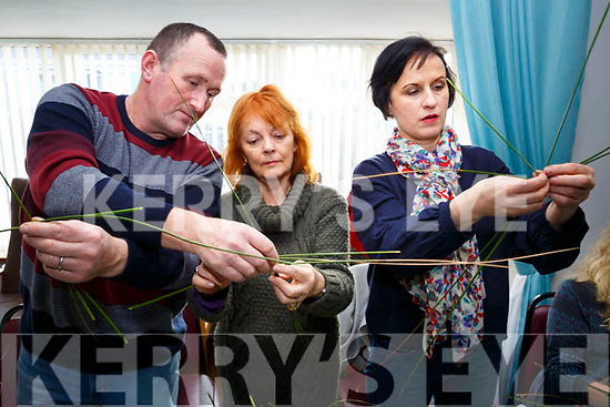 Denis O'Connor shows Sue Morley & Miriam Forde the delicate art of making a St Bridgets Cross in the Hall in Ballinskelligs on Sunday.