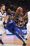 MILWAUKEE, WI - MARCH 18: Middle Tennessee Blue Raiders forward JaCorey Williams (22) dribbles past Butler Bulldogs center Nate Fowler (51) during the first half of the 2017 NCAA Men's Basketball Tournament held at BMO Harris Bradley Center on March 18, 2017 in Milwaukee, Wisconsin. (Photo by Jamie Schwaberow/NCAA Photos via Getty Images)