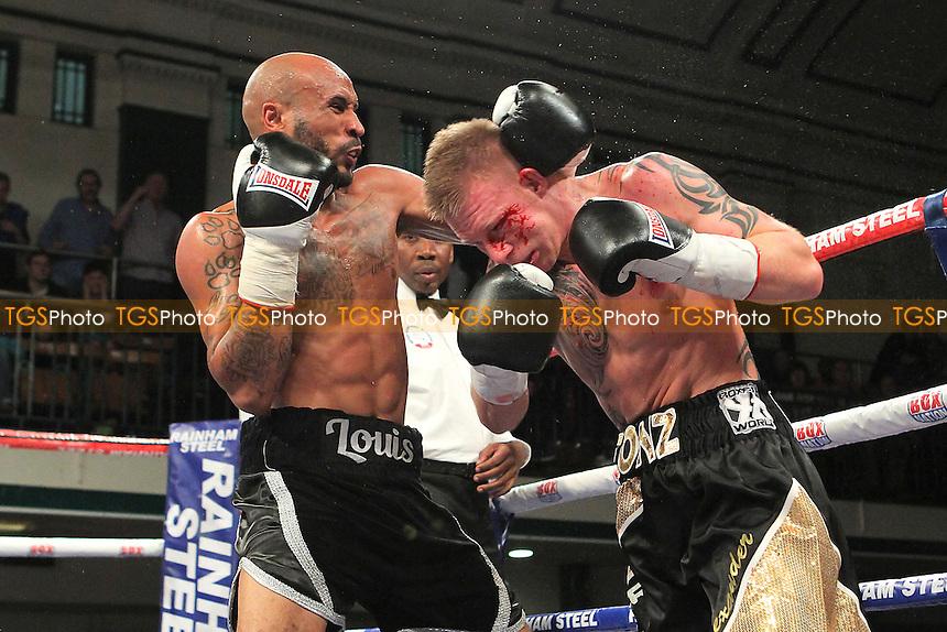 Louis Adolphe (black/white shorts) defeats Fonz Alexander in a Welterweight boxing contest at York Hall, Bethnal Green, London - 20/09/14 - MANDATORY CREDIT: Gavin Ellis/TGSPHOTO - Self billing applies where appropriate - contact@tgsphoto.co.uk - NO UNPAID USE