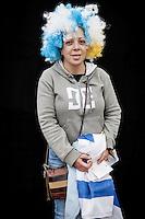 JAVIER CALVELO/  MONTEVIDEO/  ESTADIO CENTENARIO/ CLASIFICATORIAS SUDAMERICANAS MUNDIAL BRASIL 2014 / REPECHAJE MUNDIAL BRASIL 2014 - SERIE SUDAMERICA-ASIA/  PARTIDO DE VUELTA/ URUGUAY-JORDANIA<br /> Proyecto documental sobre la identidad, lo nacional, lo Uruguayo y el consumo. Se trata de retratos simples mirando a camara y con un fondo neutro. Les pregunto a los fotografiados como quieren ser recordados en el futuro y de que localidad son.<br /> El trabajo esta influenciado por la obra de August Sander pero tambien por Richard Avedon y Manuel Alvarez Bravo. <br /> El titulo esta basado en la obra de Raymond Firth, Tipos Humanos. (Raymond William Firth, ( 1901-2002) fue un etn&oacute;logo neozeland&eacute;s profesor de Antropolog&iacute;a en la London School of Economics, es uno de los fundadores de la antropolog&iacute;a econ&oacute;mica brit&aacute;nica). <br /> En la foto:  Tipos Humanos en el Estadio Centenario, Platea America. Foto: Javier Calvelo <br /> <br /> 2013-11-20 dia miercoles