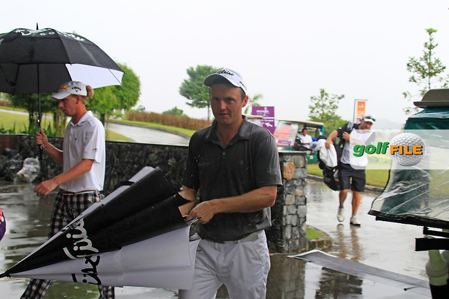 Michael Hoey (NIR) arrives back at the clubhouse as the heavens open yet again as monsoon rains fall during Saturday's storm delayed  Round 3 of the Iskandar Johor Open 2011 at the Horizon Hills Golf Resort Johor, Malaysia, 19th November 2011 (Photo Eoin Clarke/www.golffile.ie)