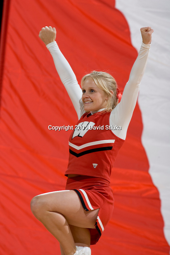 MADISON, WI - JANUARY 16:  A Wisconsin Badgers cheerleader performs during the Michigan State Spartans game at the Kohl Center on January 16, 2005 in Madison, Wisconsin. The Badgers beat the Spartans 62-59. (Photo by David Stluka)