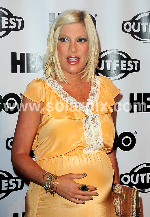 **ALL ROUND PICTURES FROM SOLARPIX.COM**                                             **SYNDICATION RIGHTS FOR UK, AUSTRALIA, DENMARK, PORTUGAL, S. AFRICA, SPAIN & DUBAI (U.A.E) & ASIA (EXCLUDING JAPAN) ONLY**                                                                                  Caption: Tori Spelling at the 29th Annual Los Angeles Gay & Lesbian Film Festival for the premiere of - Hoarders: Untold sTORI - at the John Anson Ford Amphitheatre - Hollywood, CA, USA. July 16, 2011                                                                              This pic: Tori Spelling                                                                                              JOB REF: 13733 PHZ Uema    DATE: 16_07_201                                                          **MUST CREDIT SOLARPIX.COM OR DOUBLE FEE WILL BE CHARGED**                                                                      **MUST AGREE FEE BEFORE ONLINE USAGE**                               **CALL US ON: +34 952 811 768 or LOW RATE FROM UK 0844 617 7637**