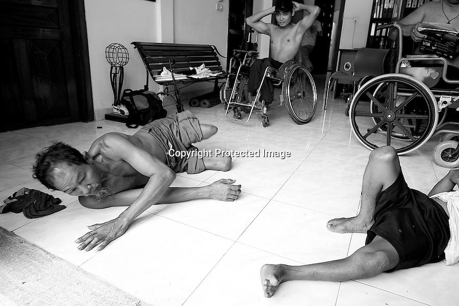 Athletes are waking up after a nap on the fresh floor of the CNVLD office. Phnom Penh, Cambodia - 2008