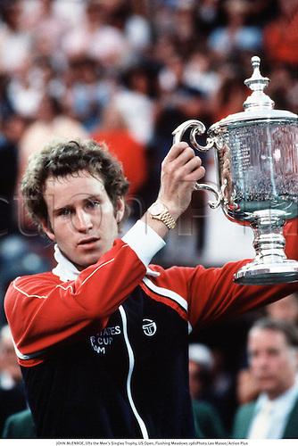 JOHN McENROE, lifts the Men's Singles Trophy, US Open, Flushing Meadows 1981Photo:Leo Mason/Action Plus...1981.Tennis.Winners winner wins win winning.man.trophies.cup cups
