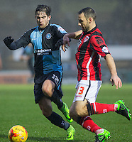Max Kretzschmar of Wycombe Wanderers & Alan Goodall of Morecambe  battle during the Sky Bet League 2 match between Wycombe Wanderers and Morecambe at Adams Park, High Wycombe, England on 2 January 2016. Photo by Andy Rowland / PRiME Media Images