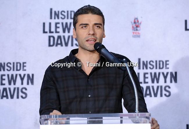 Oscar Isaac  at the ceremony honoring John Goodman  with hand and foot print at the TCL Chinese Theatre in Los Angeles.