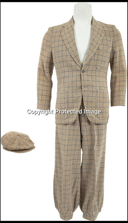 BNPS.co.uk (01202 558833)<br /> Picture: HeritageAuctions/BNPS<br /> <br /> ****Please use full byline****<br /> <br /> The beige and navy outfit which is expected to fetch &pound;4,000.<br /> <br /> The water-stained grey woolen suit worn by Hollywood superstar Gene Kelly as he belted out the title number from hit musical Singin' in the Rain is for sale for &pound;100,000.<br /> <br /> Kelly donned the two piece suit for the iconic centrepiece of the 1952 comedy in which he famously splashed through puddles twirling an umbrella during a downpour.<br /> <br /> Also for sale is Kelly's beige and navy outfit from the scene where Lockwood meets Cosmo Brown, played by co-star Donald O'Connor, on the set of a movie which is expected to fetch &pound;4,000 at the Heritage Auctions sale on December 6.