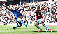 Burnley's Johann Gudmundsson crosses despite the attentions of Leicester City's Danny Simpson<br /> <br /> Photographer Rich Linley/CameraSport<br /> <br /> The Premier League - Burnley v Leicester City - Saturday 14th April 2018 - Turf Moor - Burnley<br /> <br /> World Copyright &copy; 2018 CameraSport. All rights reserved. 43 Linden Ave. Countesthorpe. Leicester. England. LE8 5PG - Tel: +44 (0) 116 277 4147 - admin@camerasport.com - www.camerasport.com