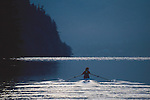 Rowing, Woman rowing wilderness lake in single racing shell, Lake Whatcom, Bellingham area, Washington state, Gwen Howat,