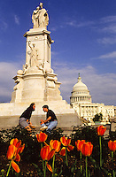 A statue and the Capitol in Washington DC, USA