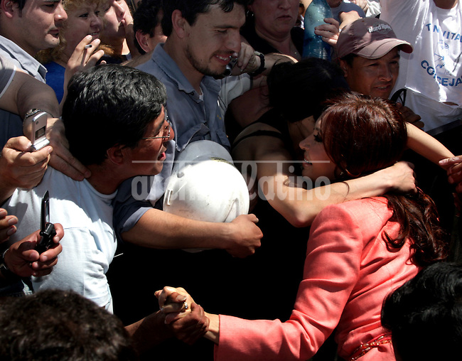 Workers kiss and embrace Argentina First Lady and Presidential candidate Cristina Fernandez de Kirchner during the inauguration of a school-factory for specialized workers.Polls show Cristina as the favorite candiate for October 28th national election.....