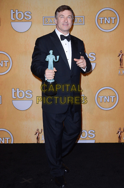 Alec Baldwin.Pressroom at the 19th Annual Screen Actors Guild Awards held at The Shrine Auditorium, Los Angeles, California, USA..27th January 2013.SAG SAGs full length black tuxedo bow tie white shirt award trophy winner hand arm.CAP/ADM/TW.©Tonya Wise/AdMedia/Capital Pictures.