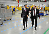 United States President Barack Obama (L) tours Orion Energy Systems, Inc. with founder and CEO Neal Verfuerth  in Manitowoc, Wisconsin on Wednesday, January 26, 2011. President Obama, Vice President Joe Biden and other members of the President's Cabinet traveled across the country Wednesday to highlight the administration's efforts to rebuild the American economy.  .Credit: Brian Kersey / Pool via CNP