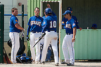 22 May 2009: Matthieu Brelle Andrade of Senart, next to Rhett Teller, congratulates Samuel Meurant during the 2009 challenge de France, a tournament with the best French baseball teams - all eight elite league clubs - to determine a spot in the European Cup next year, at Montpellier, France. Senart wins 7-1 over Montpellier.